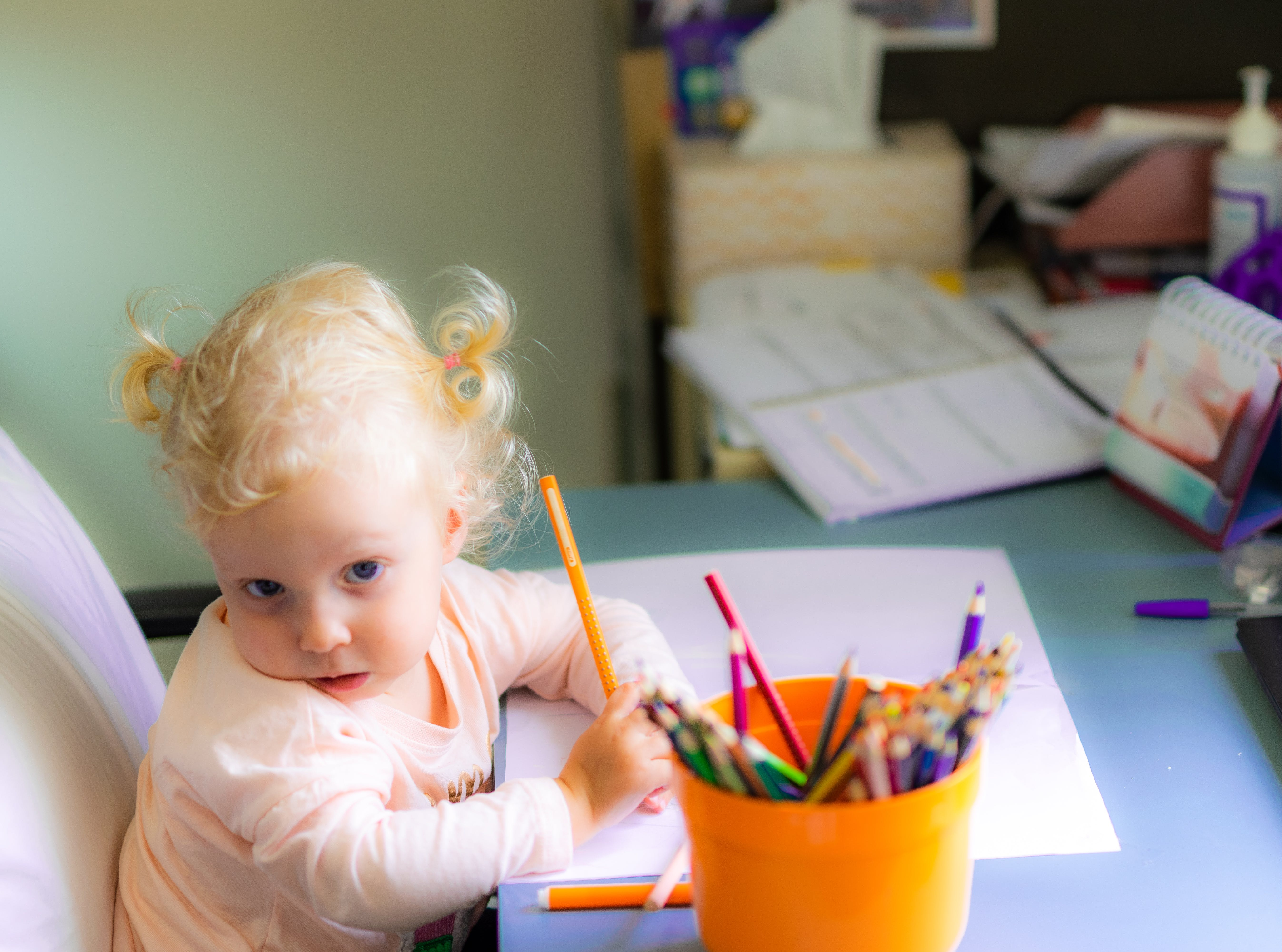 Free stock photo of blonde hair, blue eyes, chair, colored pencils