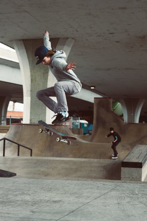 Selective Focus Photography Of Man Riding Skateboard Doing Kick Flip