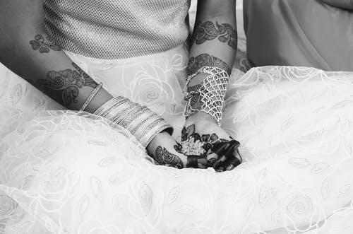 Grayscale Photography of Woman With Henna Tattoo