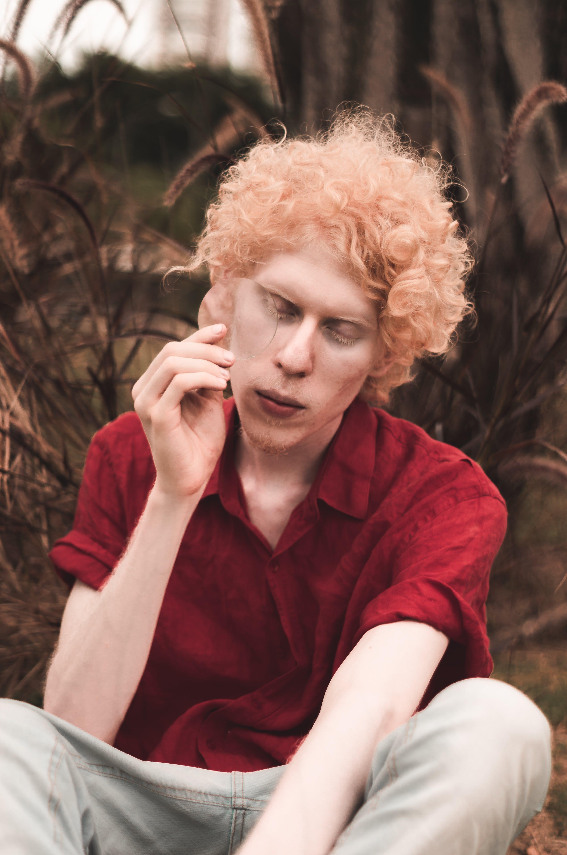 Man Wearing Red Collared Shirt
