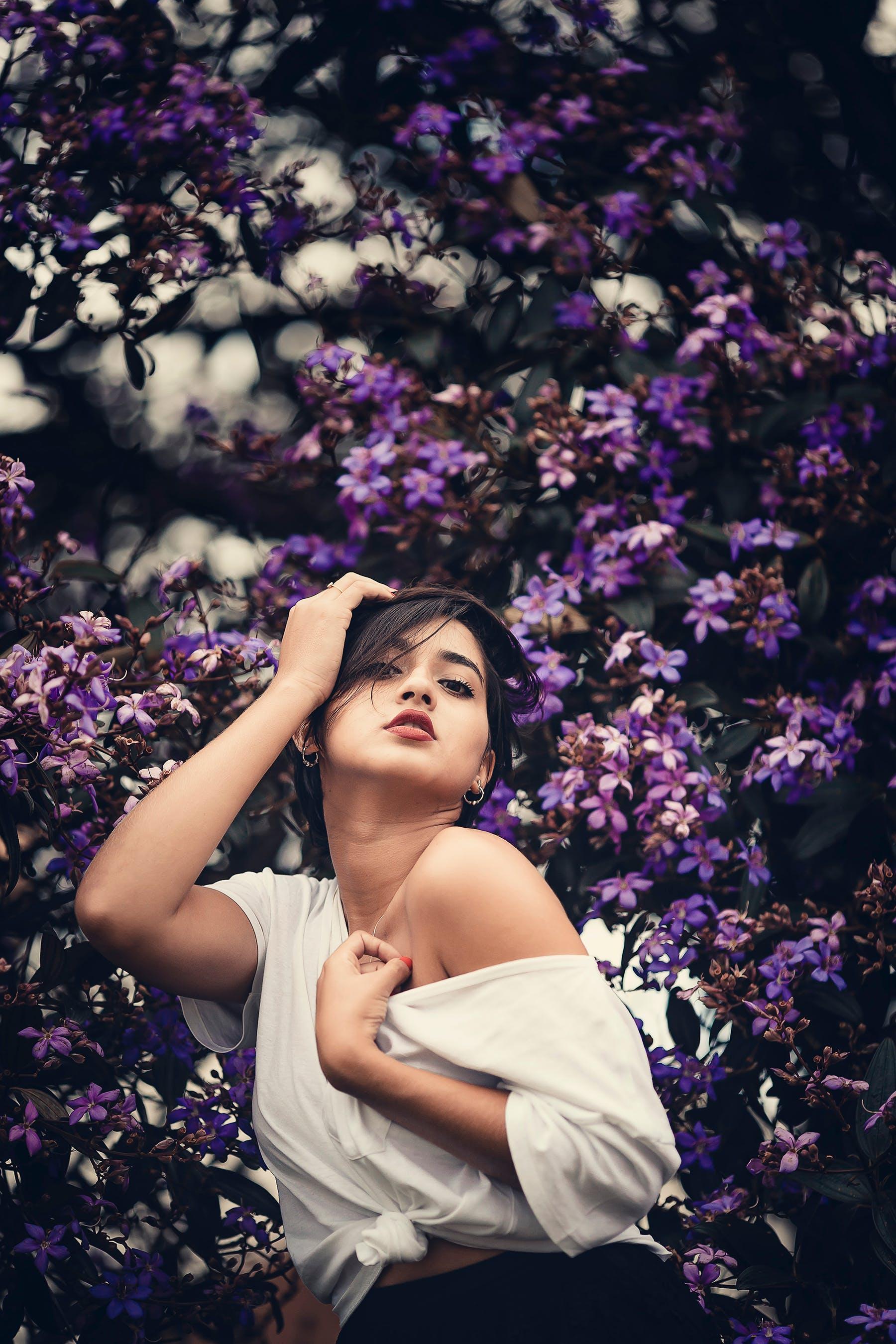 Woman Wearing White Shirt Near Purple Flowers