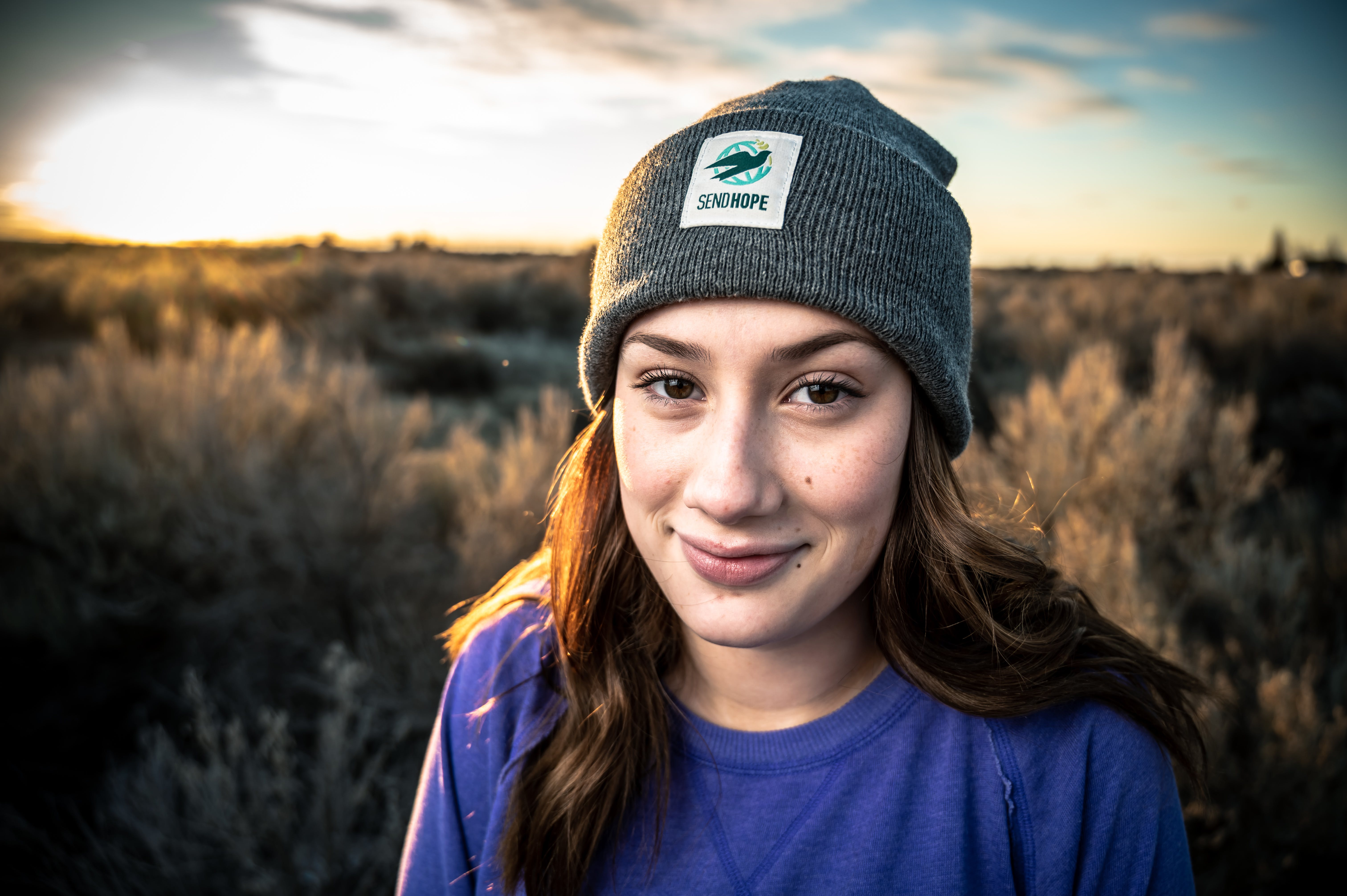 Woman Wearing Blue Shirt And Grey Beanie