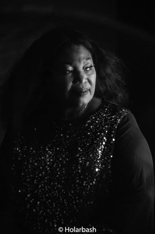 Free stock photo of black and white, black background, portrait, portrait photography