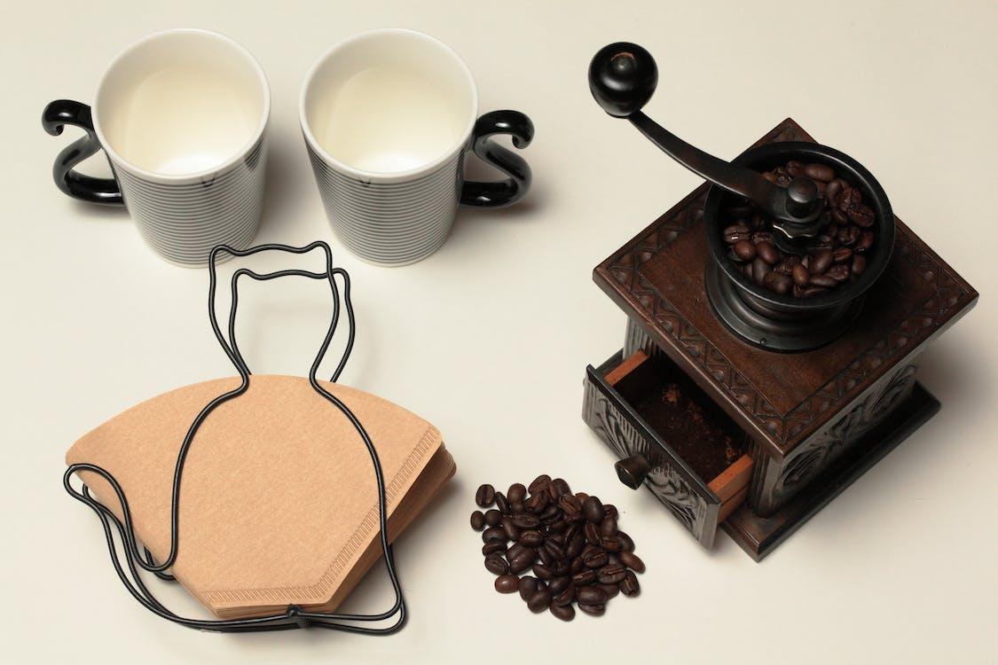 Vintage Brown Coffee Grinder on White Surface