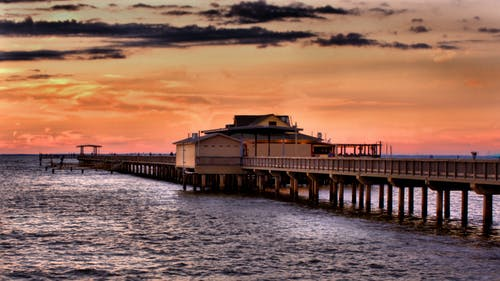 Free stock photo of sunset clouds pier ocean pink landscape