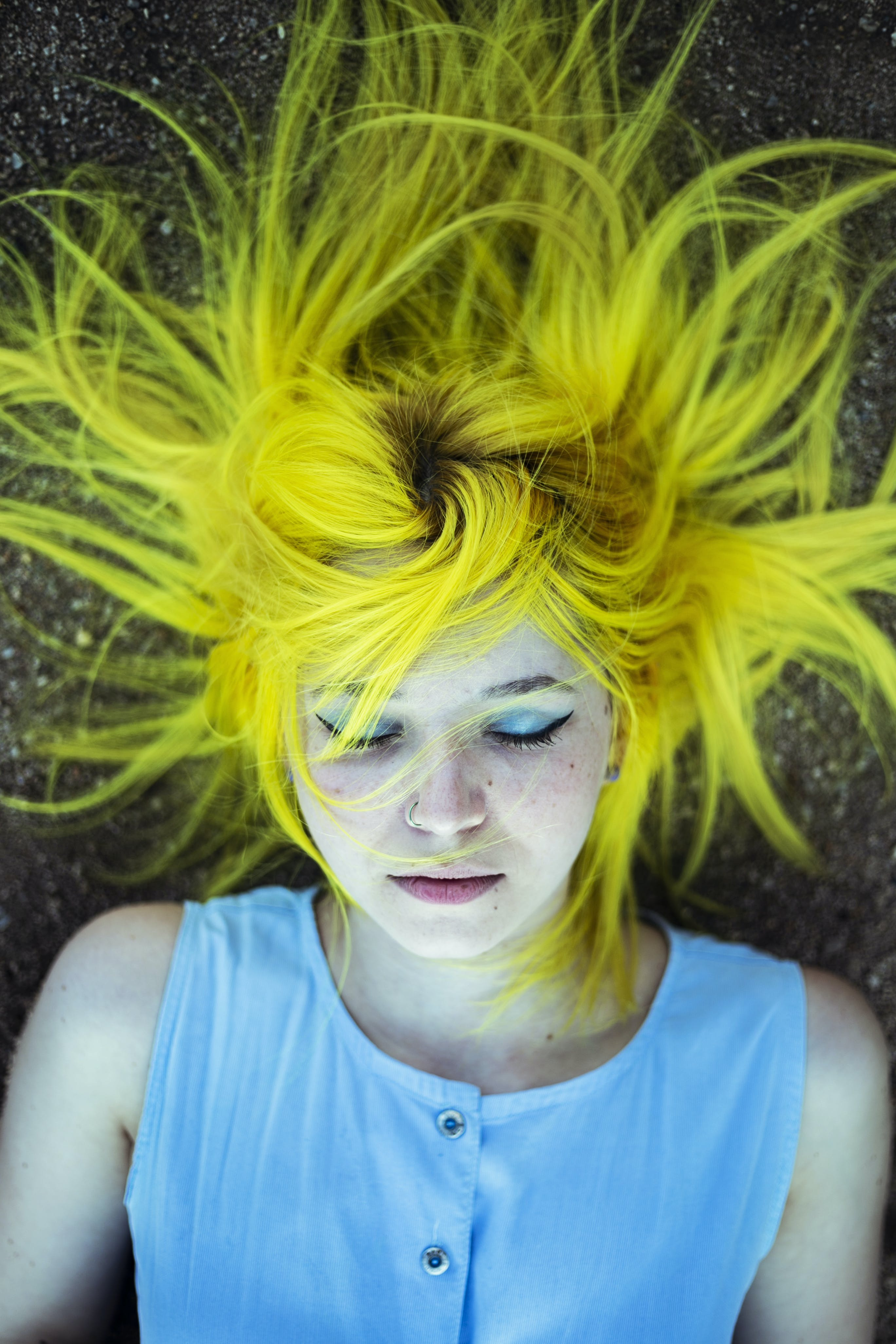 Woman With Yellow Hair Lying On The Ground