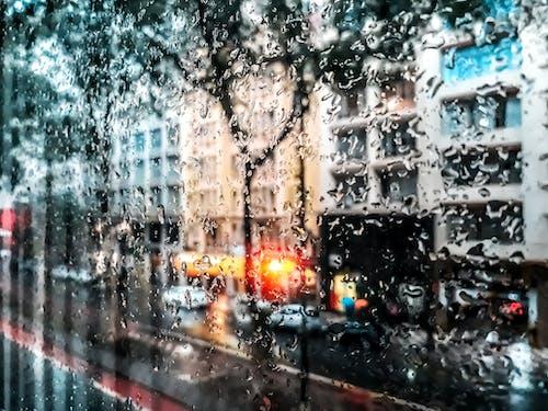 Бесплатное стоковое фото с городская зона, городской пейзаж, дождь, капли