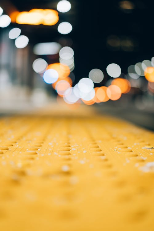 Close View of Pavement With Bokeh Light Background
