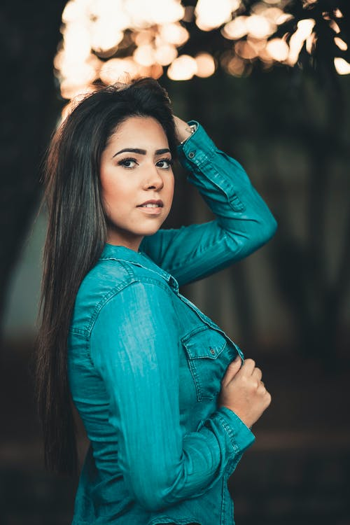 Woman Wearing Teal Long-sleeved Shirt