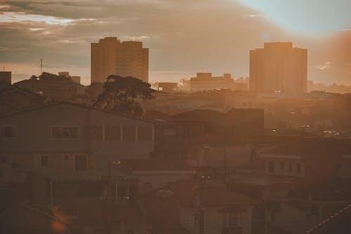 Free stock photo of bairro, casas, golden sun, Luz do sol