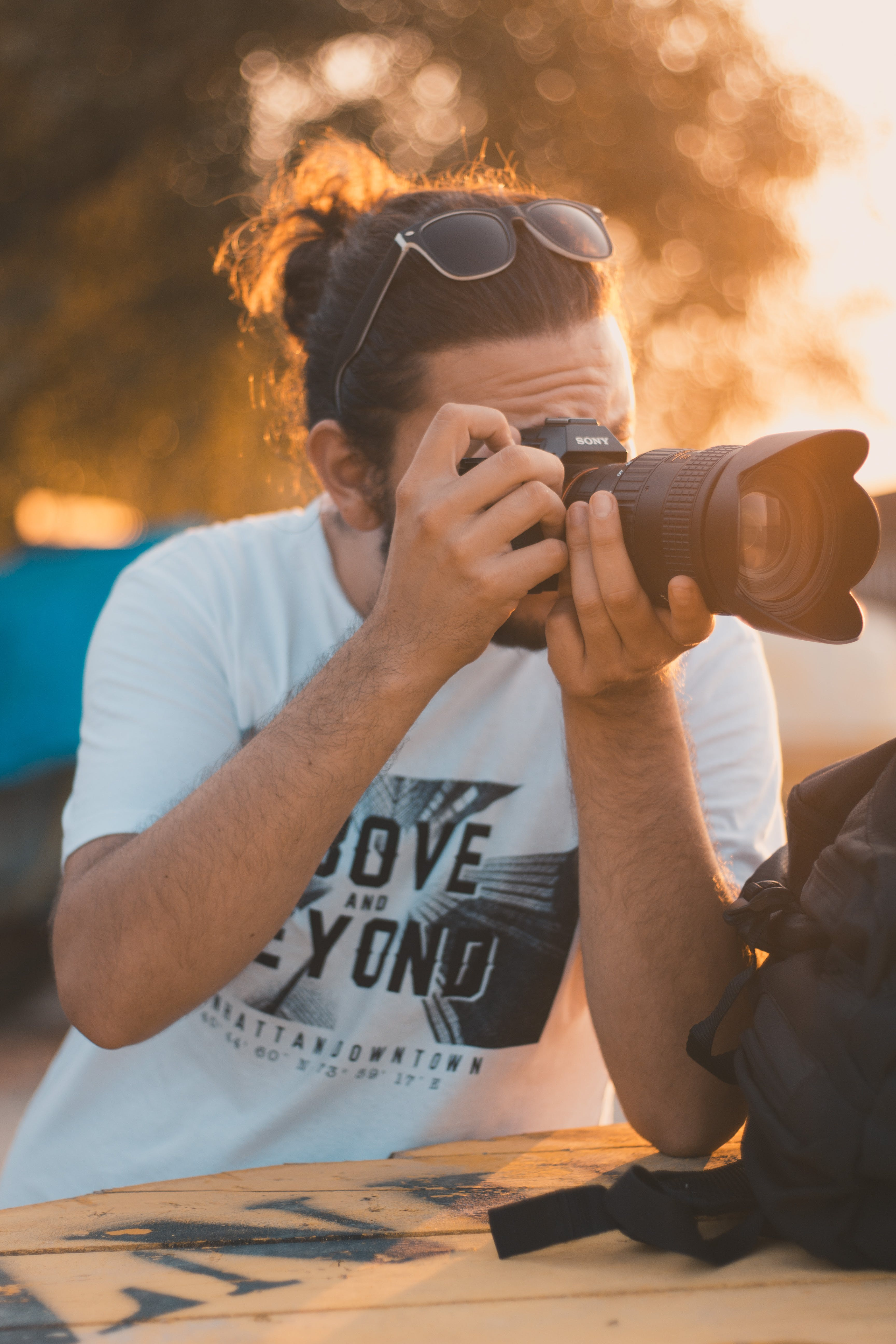 Photo of Man Taking Photo with Dslr Camera