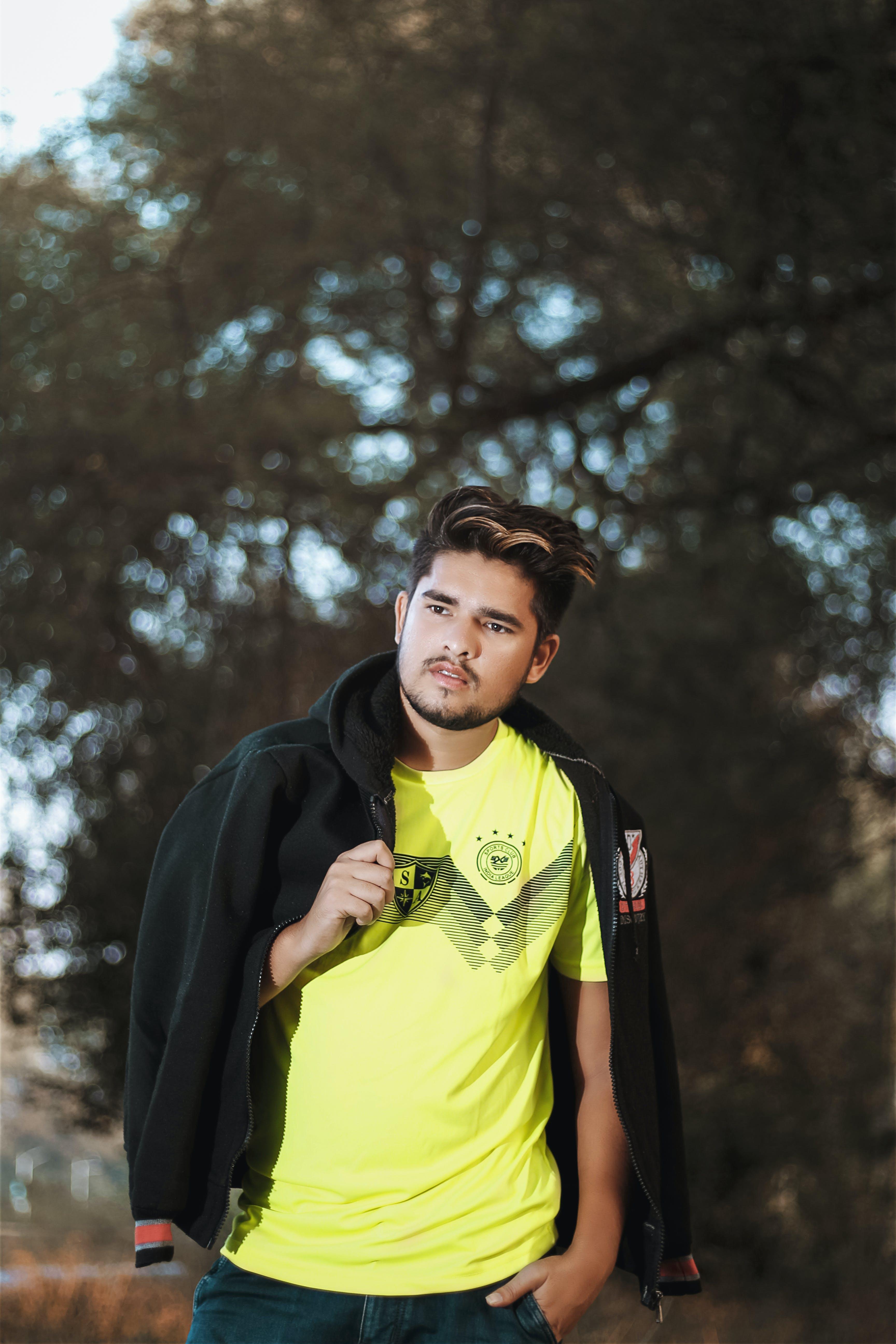 Photo of Man Carrying Black Jacket Posing