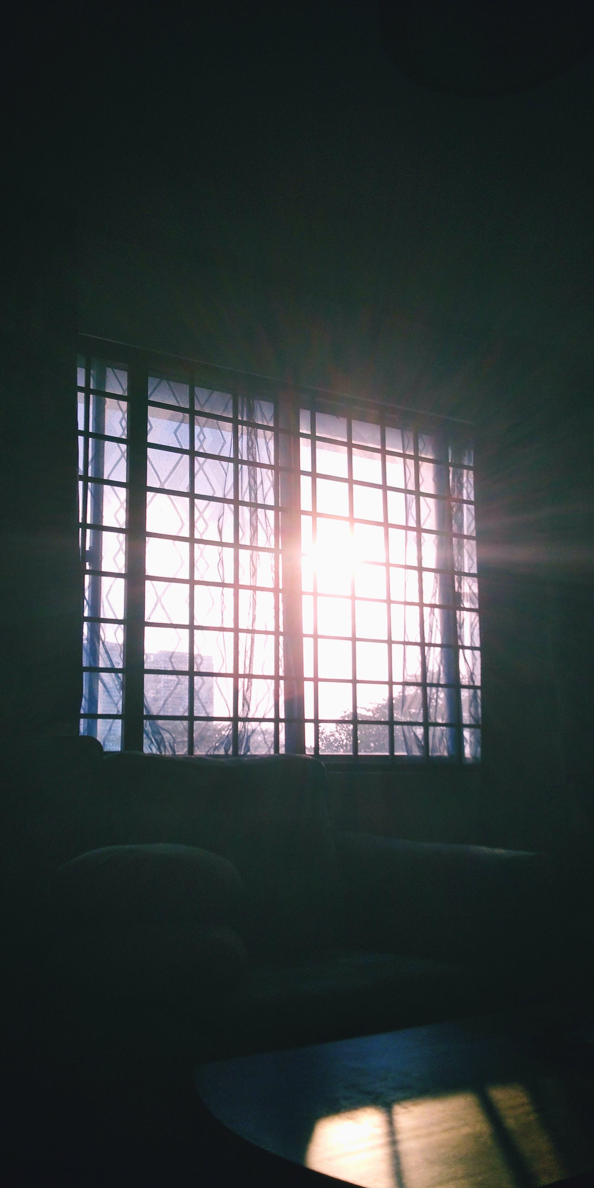 Free stock photo of church window, dark, light beam