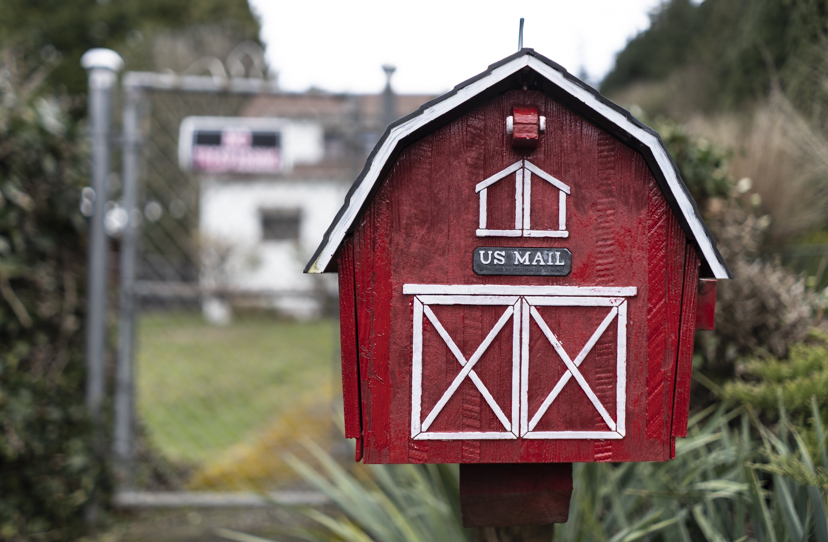 White and Red Wooden Barn Mailbox