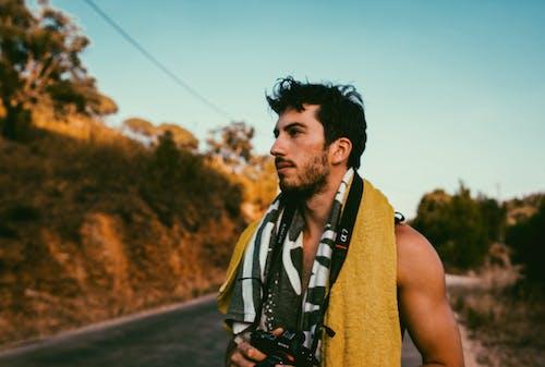 Man Holds Dslr Camera