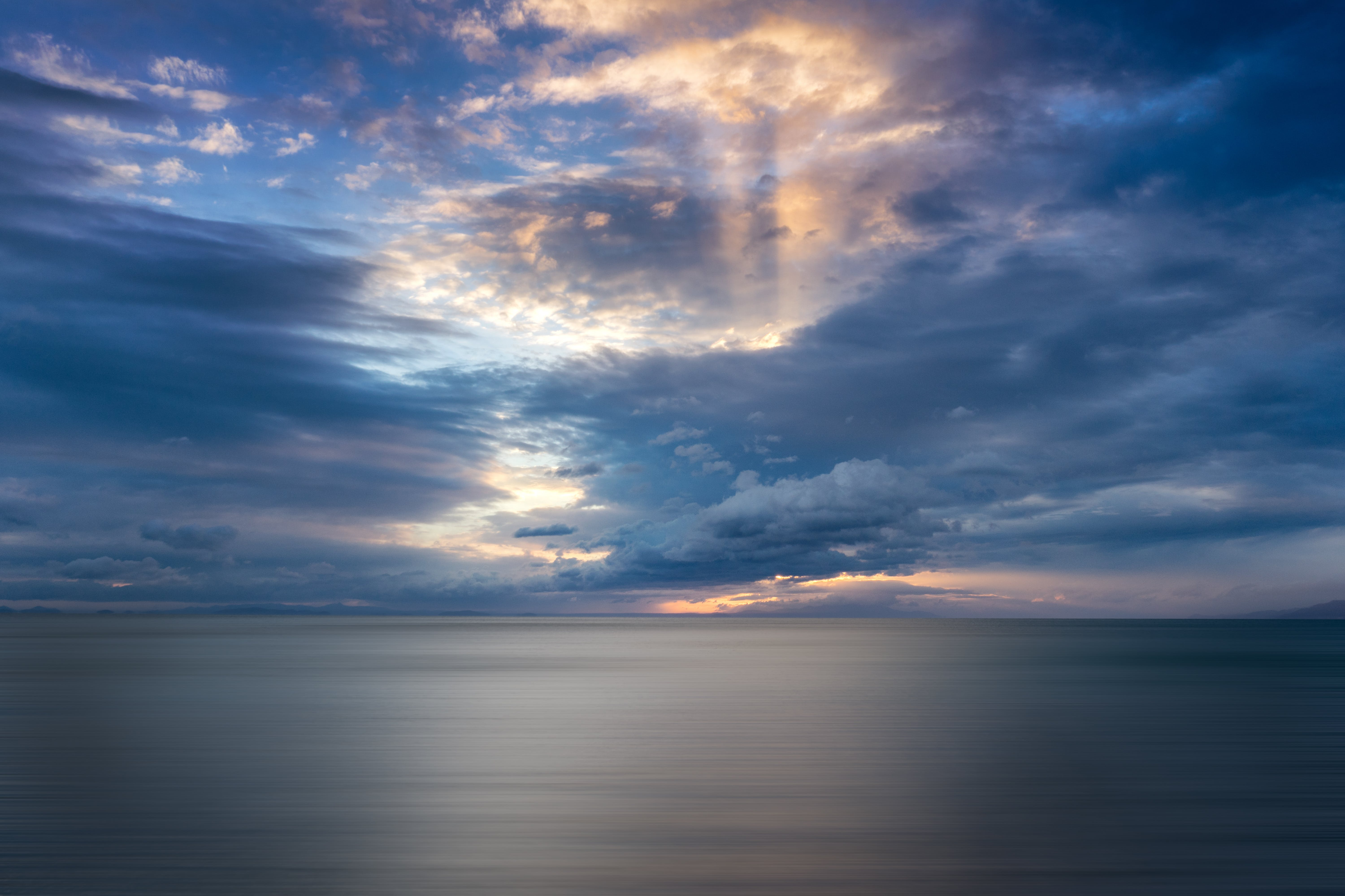 Free stock photo of clouds, long exposure, sea, sunrays