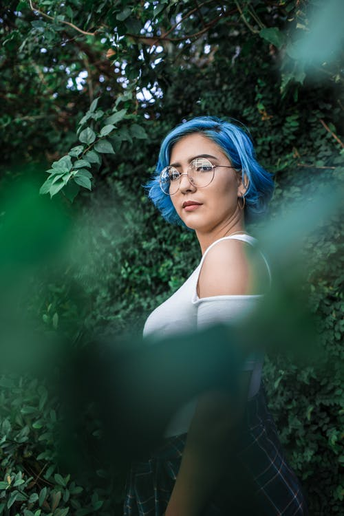 Woman With Blue Hair and White Cold-shoulder Top