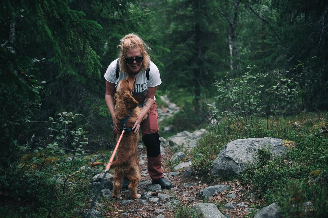 Woman and Dog on Trail