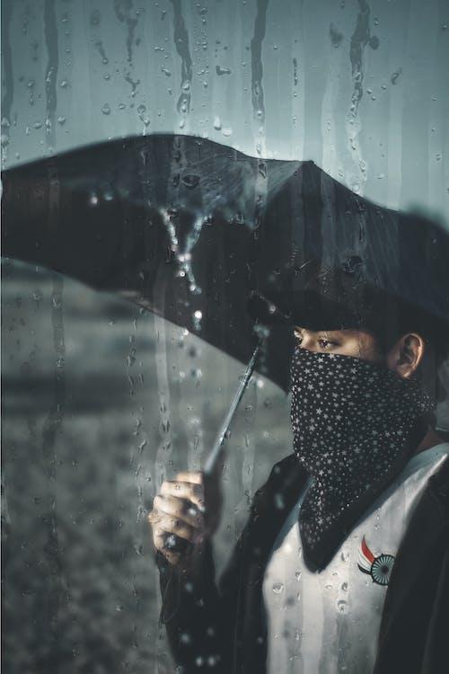 Woman Carrying Black Umbrella