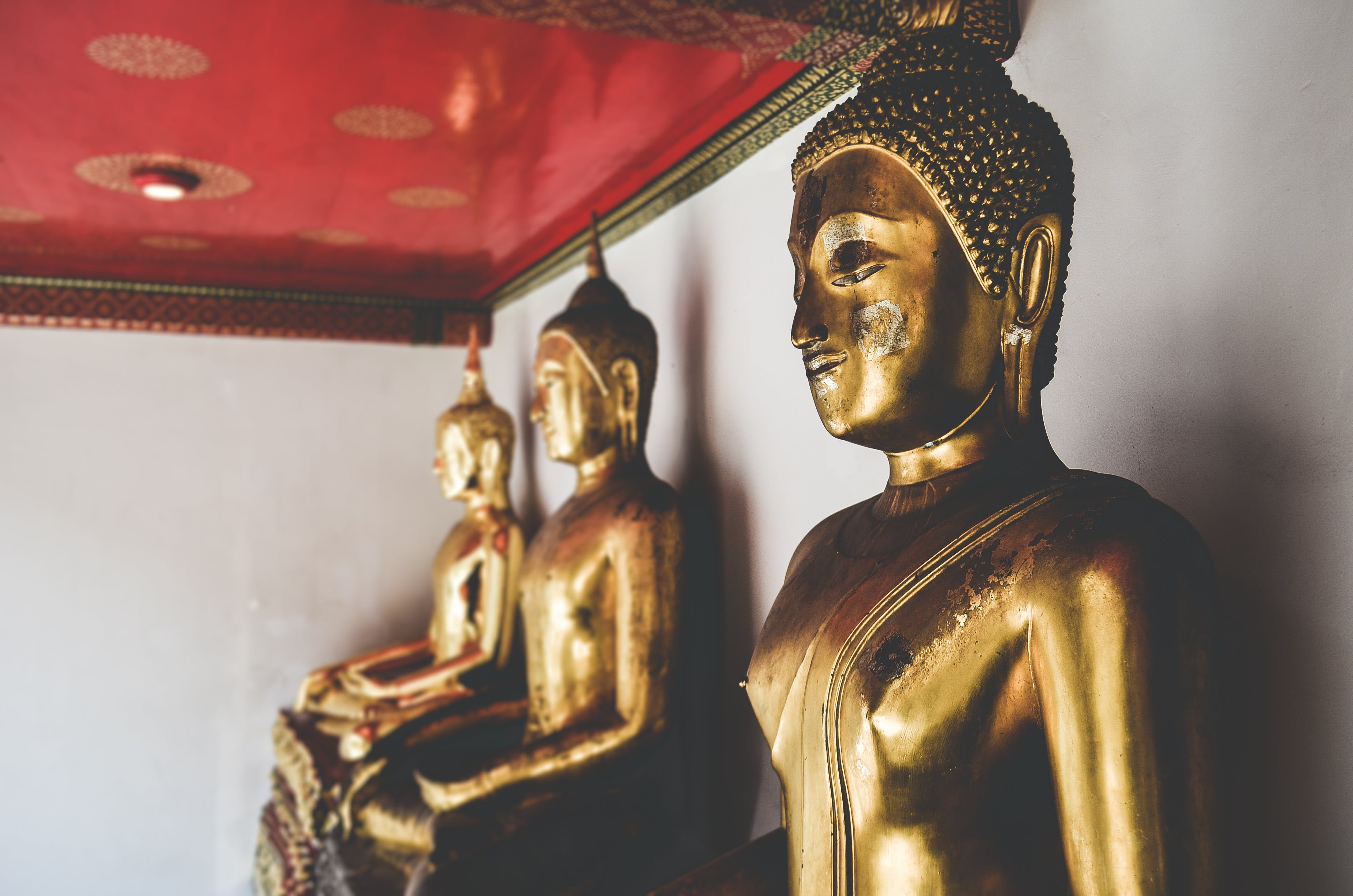 Three Golden Buddha Statue