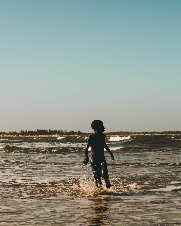 Boy on Body of Water