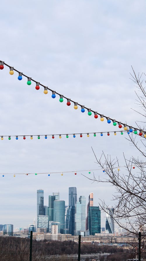 Colorful bulb light garland against Moscow City