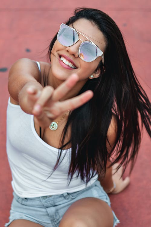 Woman Smiling and Peace Sign