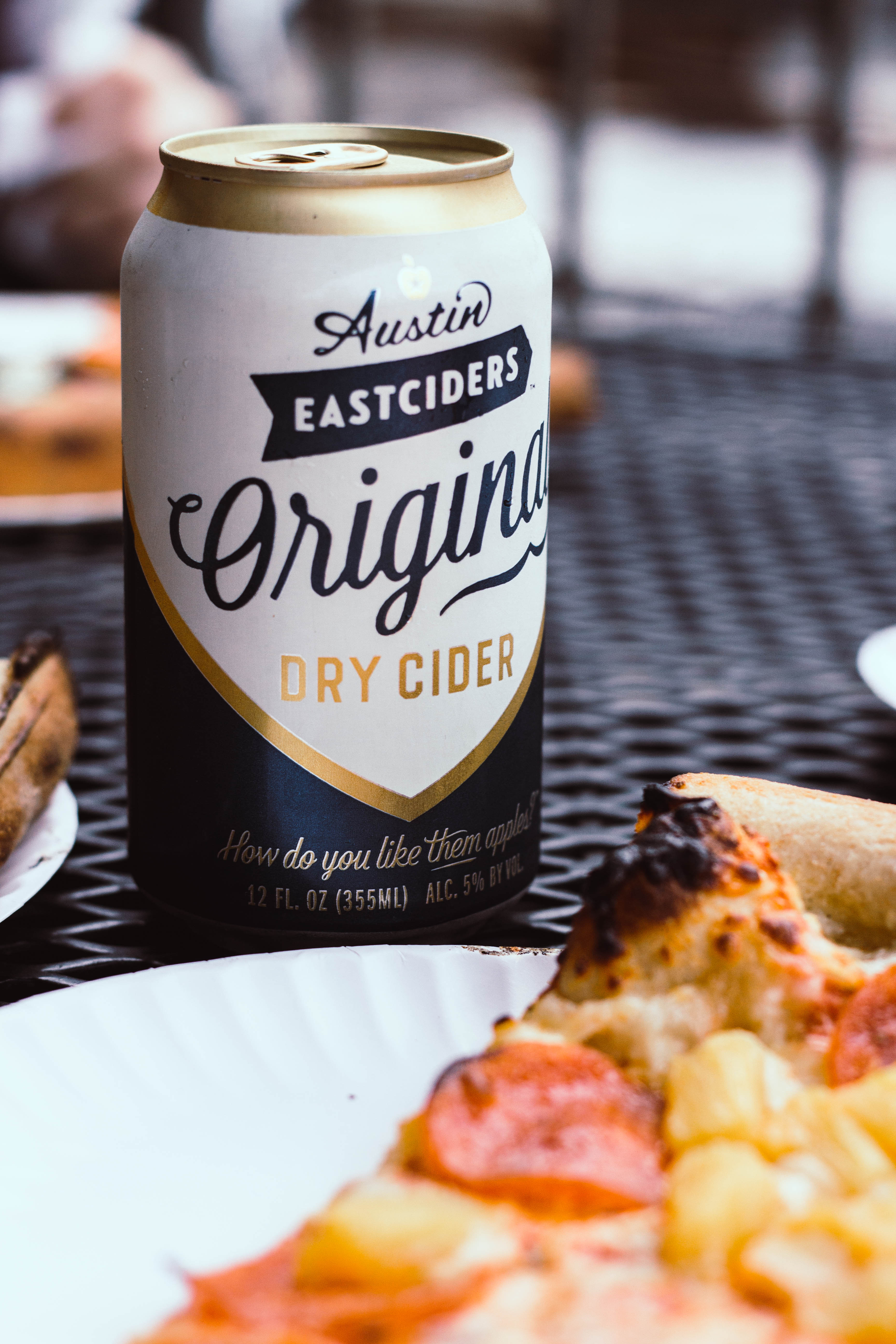 Austin Eastciders Dry Cider Can on Black Metal Table