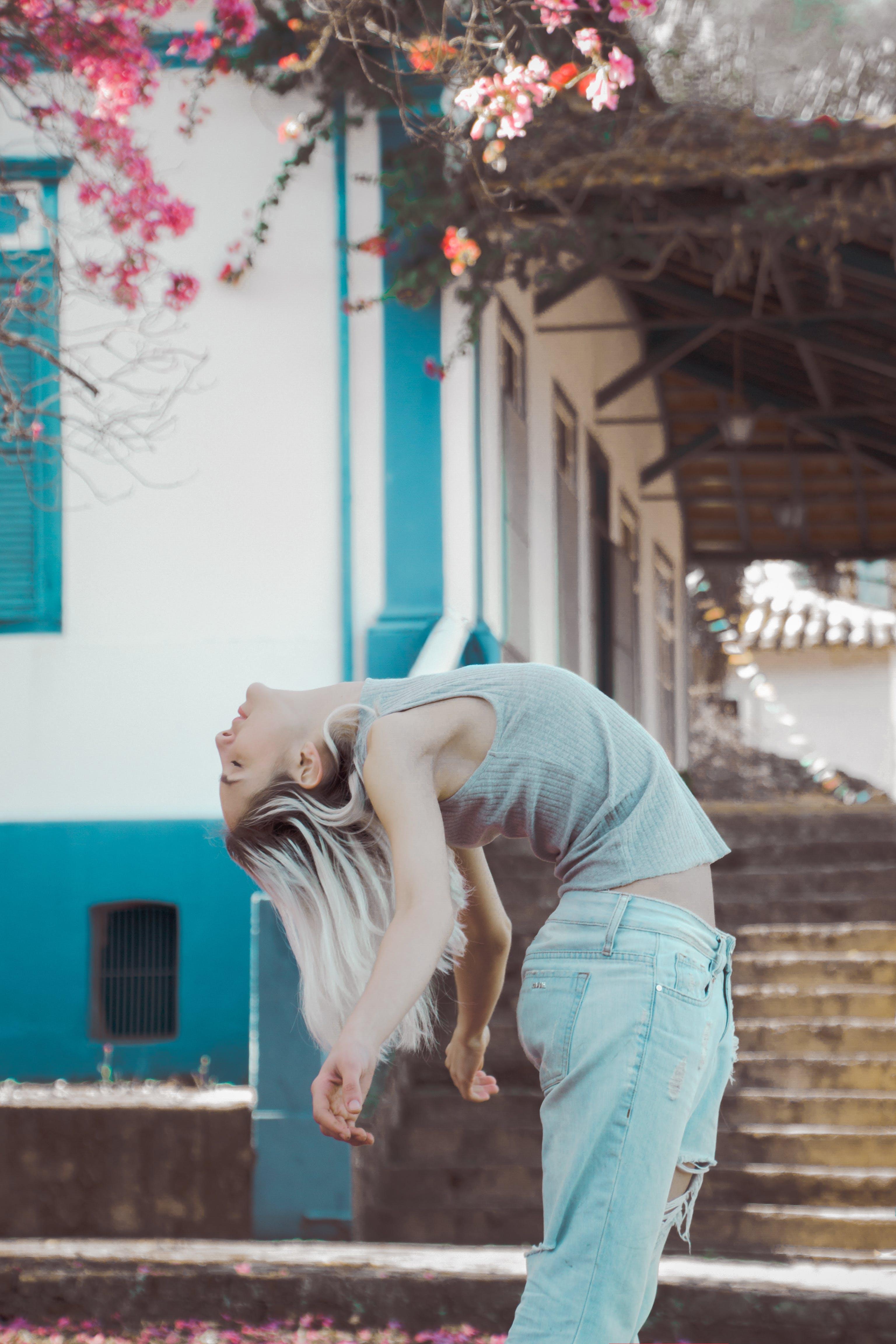 Woman Bending Beside House
