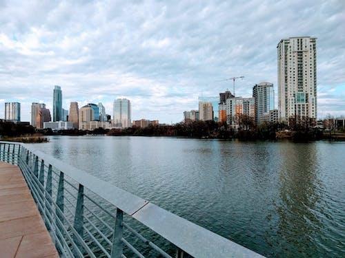 Gratis lagerfoto af austin, blåt vand, by, bygninger