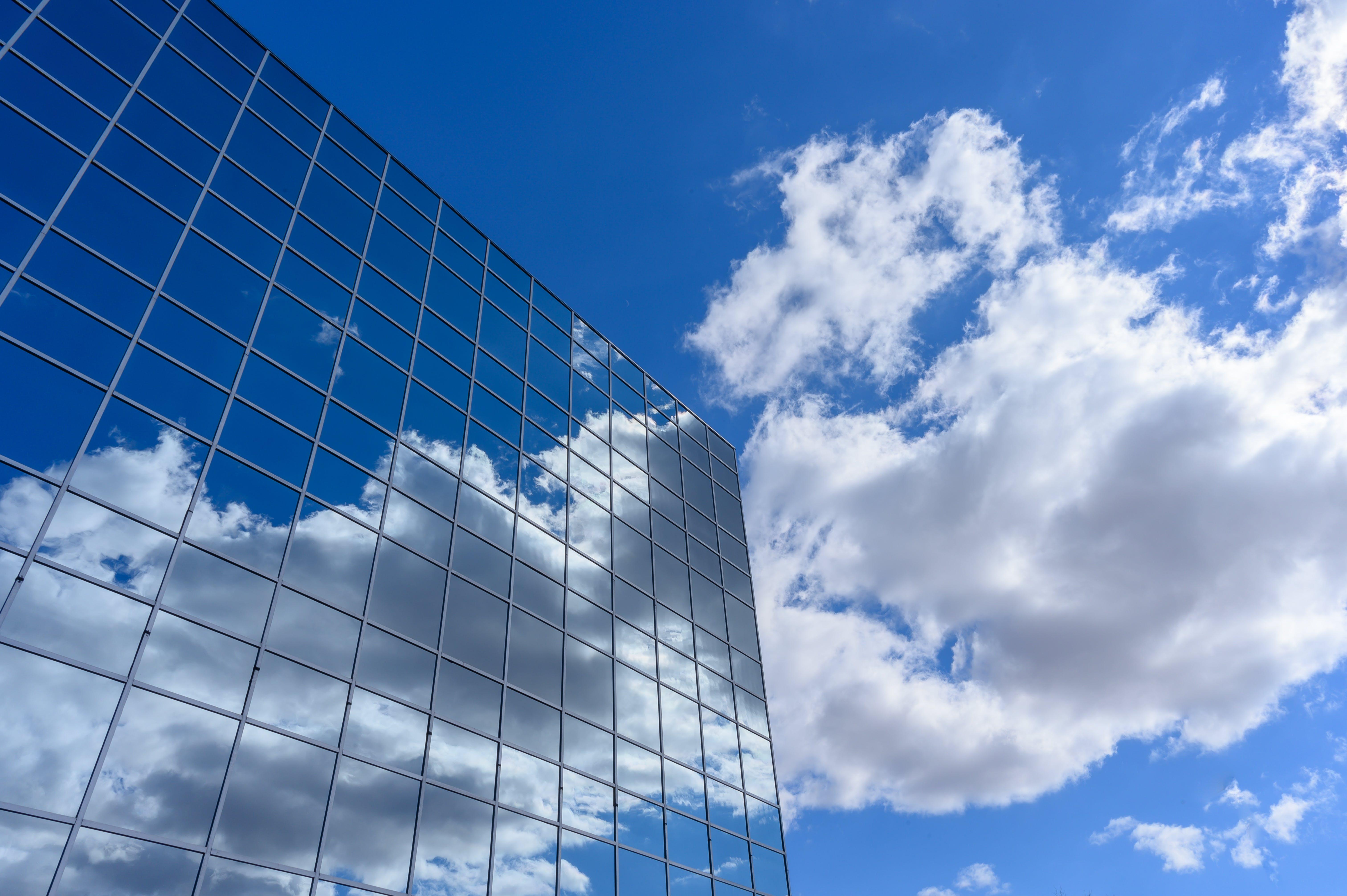 Curtain Wall Building Under Clear Blue Sky