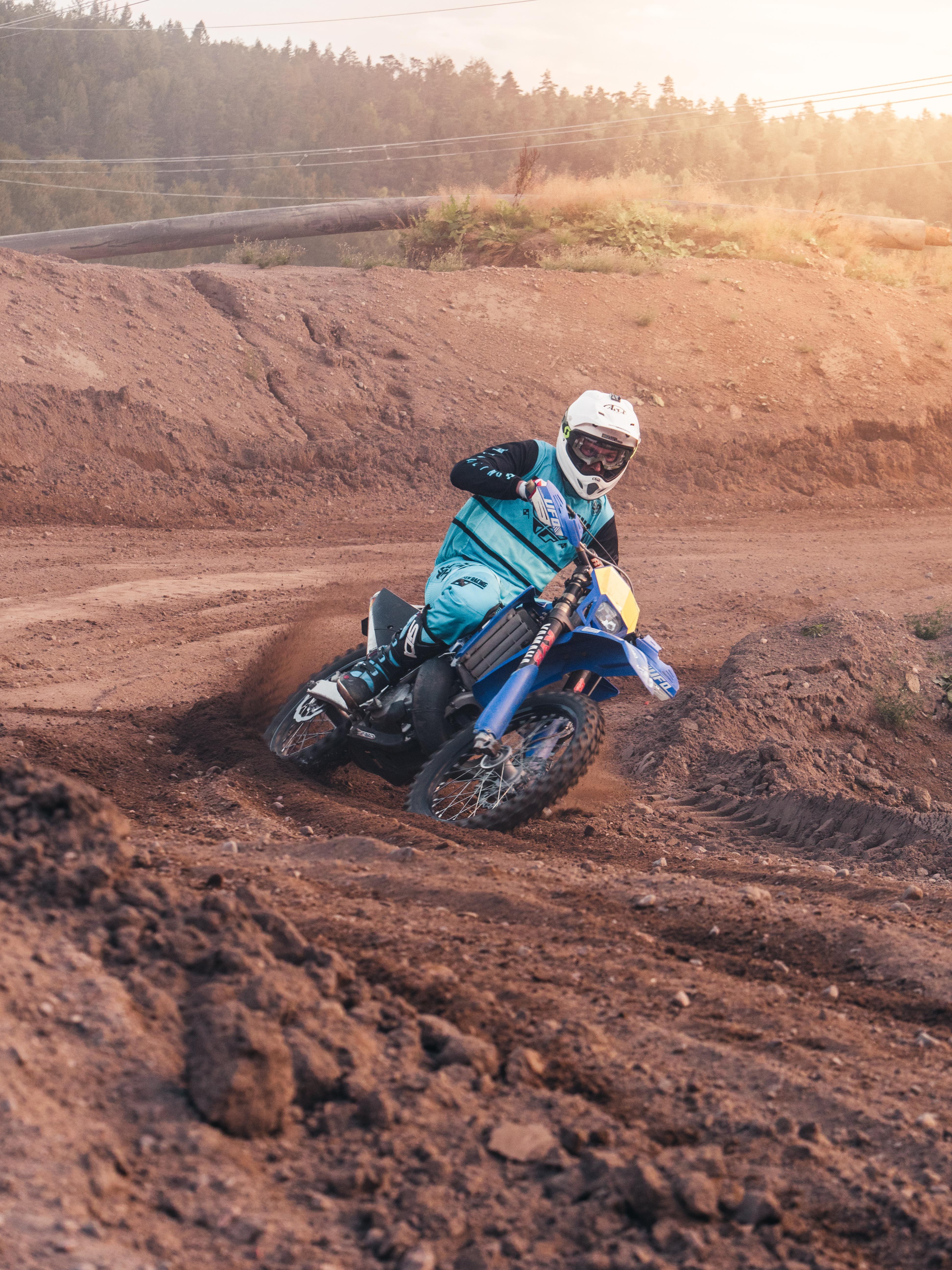 Person Riding on Motocross Dirt Bike