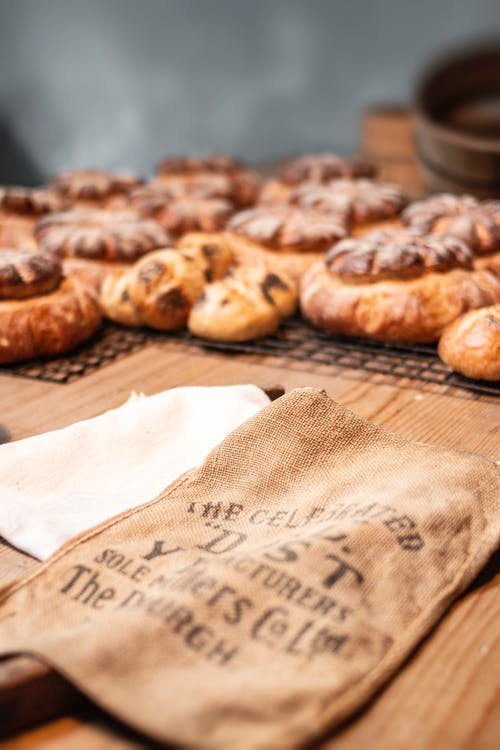 Bag on Wood Beside Cooked Breads