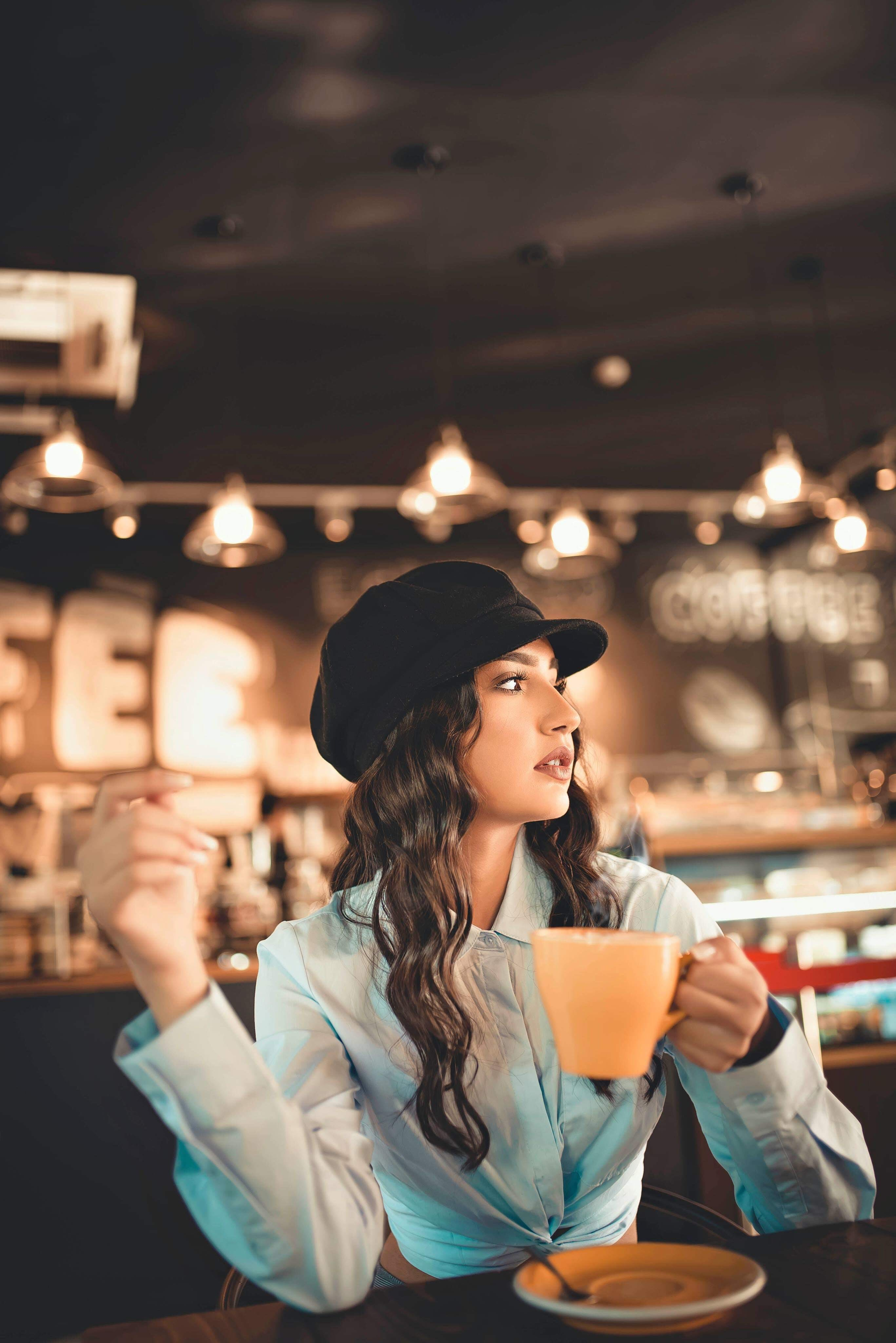 Woman Holds Hot Beverage Cup at the Restaurant