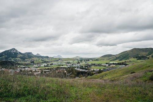 bulutlar, bulutlu, çim, kış içeren Ücretsiz stok fotoğraf