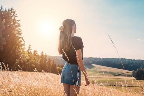 Woman Standing on Wheat Field