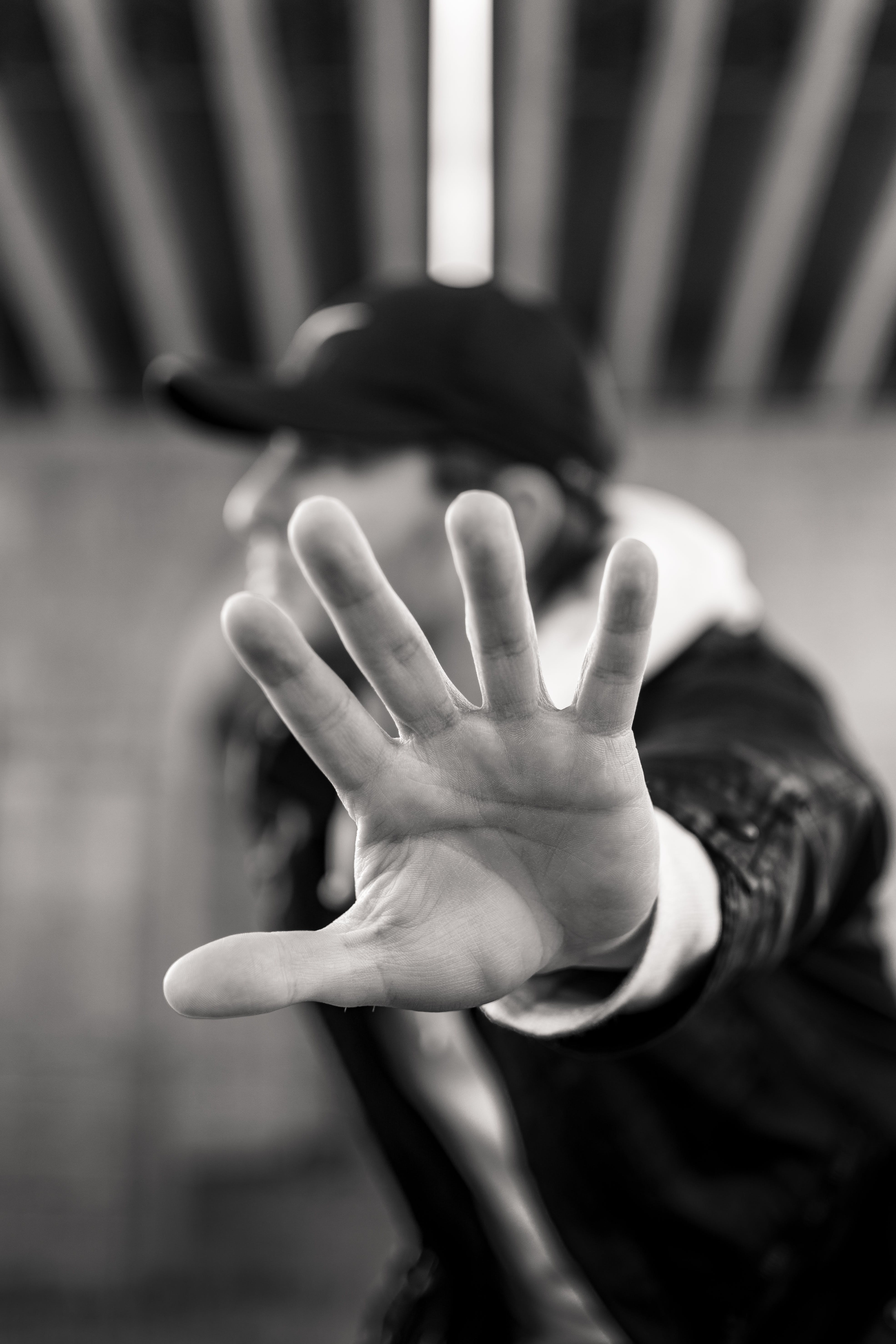 Monochrome Photo of Man Showing His Left Hand