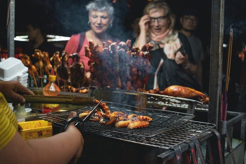 People Watching Barbecues Getting Cooked