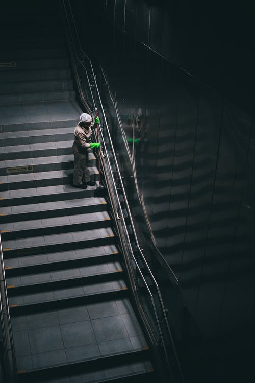 Person Standing on Stairs