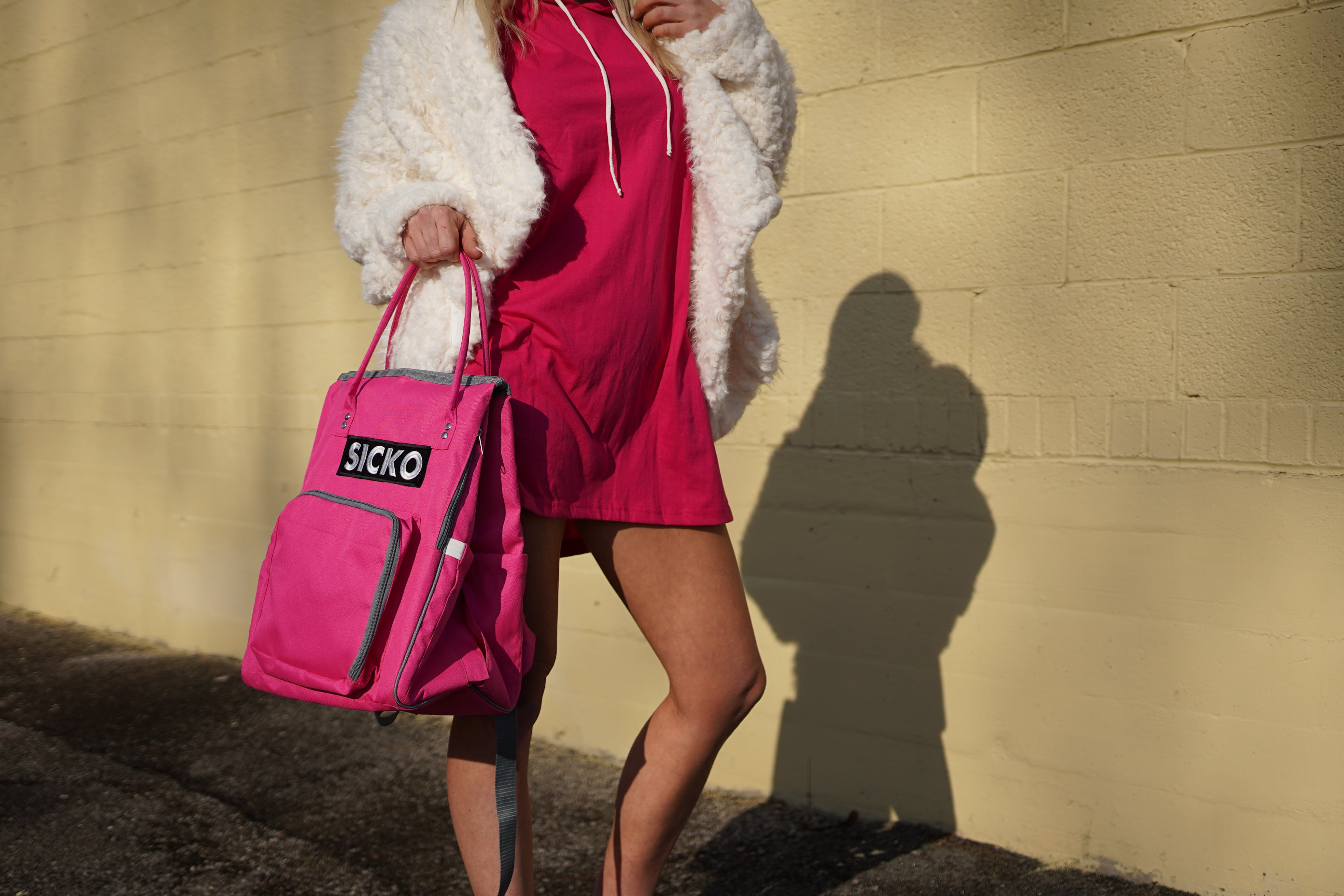 Woman Wearing Red Dress Carrying Pink Bag