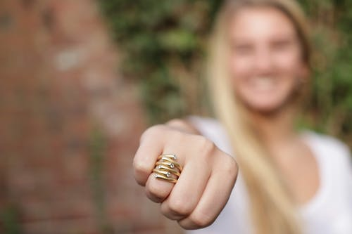 Close-Up Photo of Woman Wearing Golden Ring