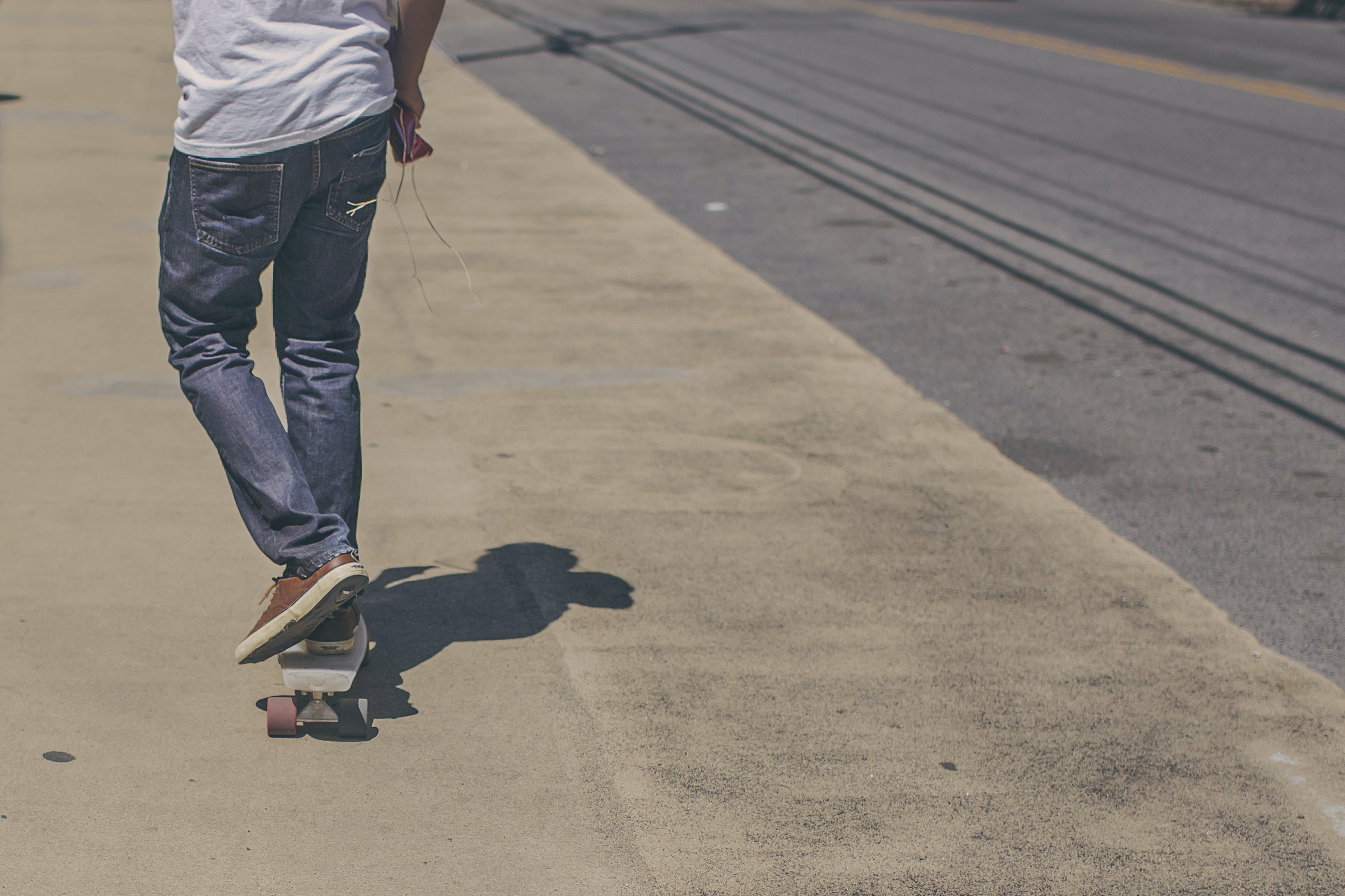 Man Riding Skateboard on Road