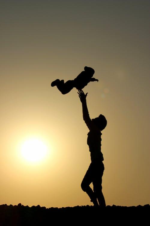 Foto profissional grátis de alvorecer, bebê, captura, cenário