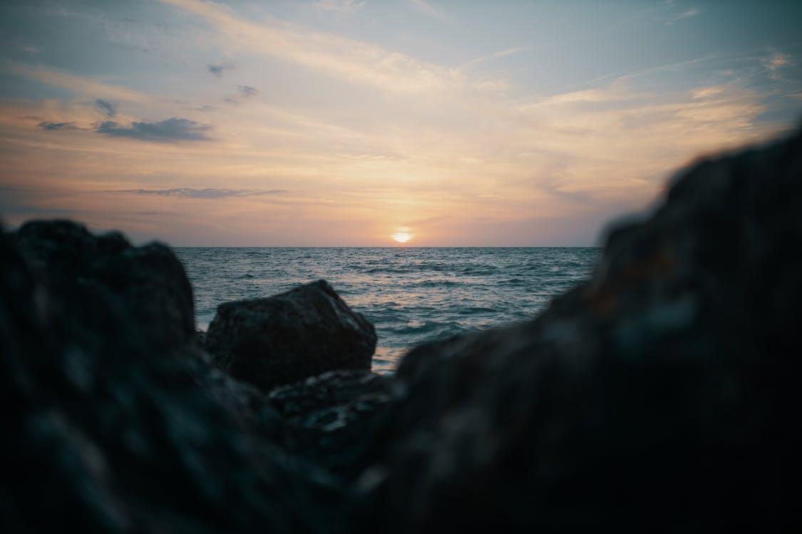 Selective Focus Photography Of Stones Near Ocean