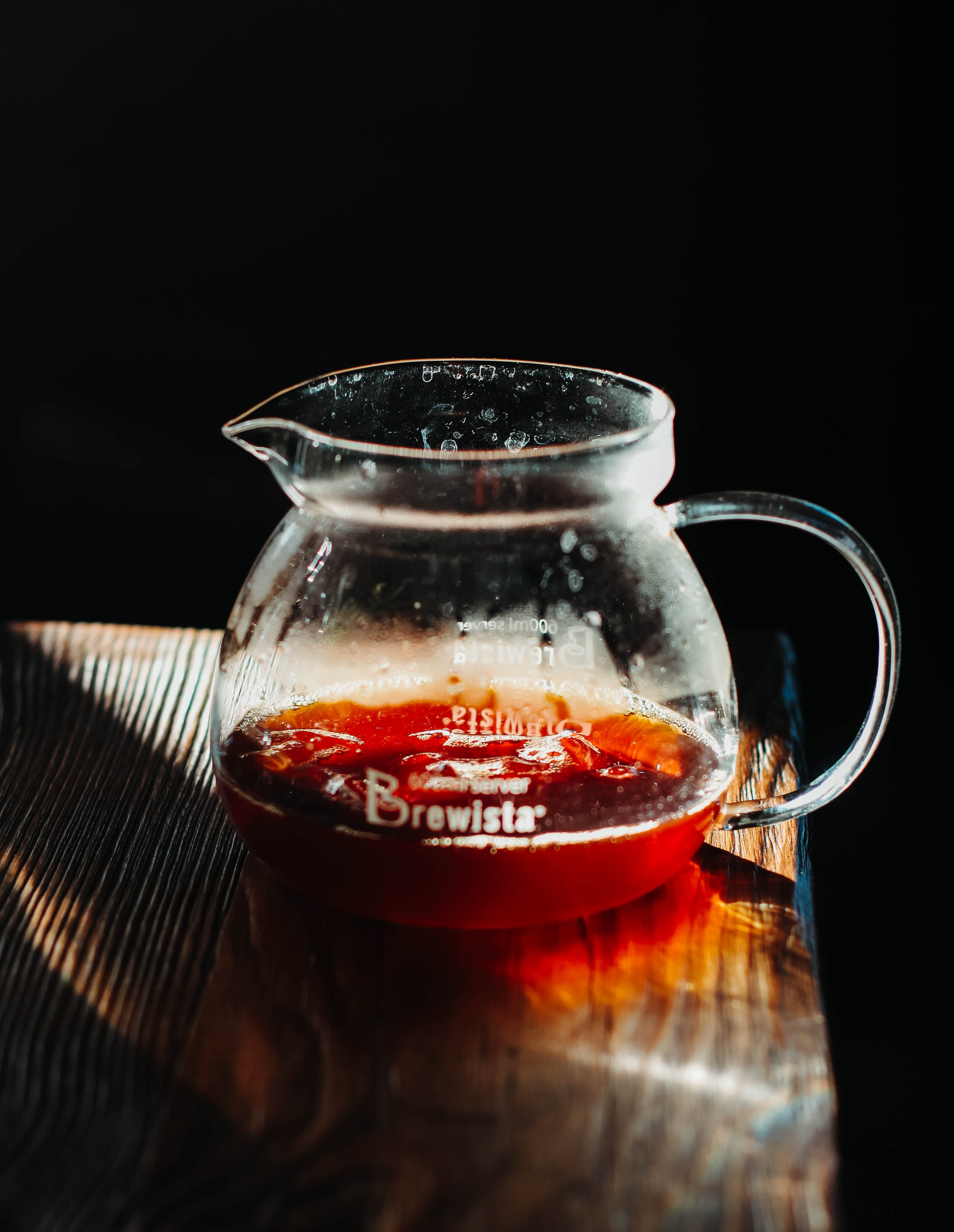 Clear Glass Pitcher On Brown Wooden Surface