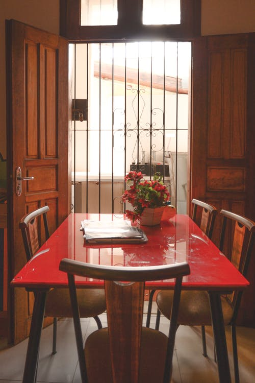 Red Dining Table With Brown Wooden Chairs