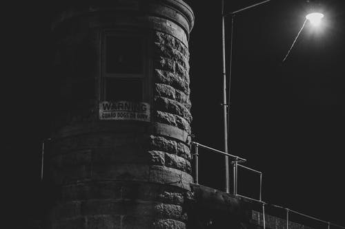 Free stock photo of black and white, penitentiary, prison, street lamp