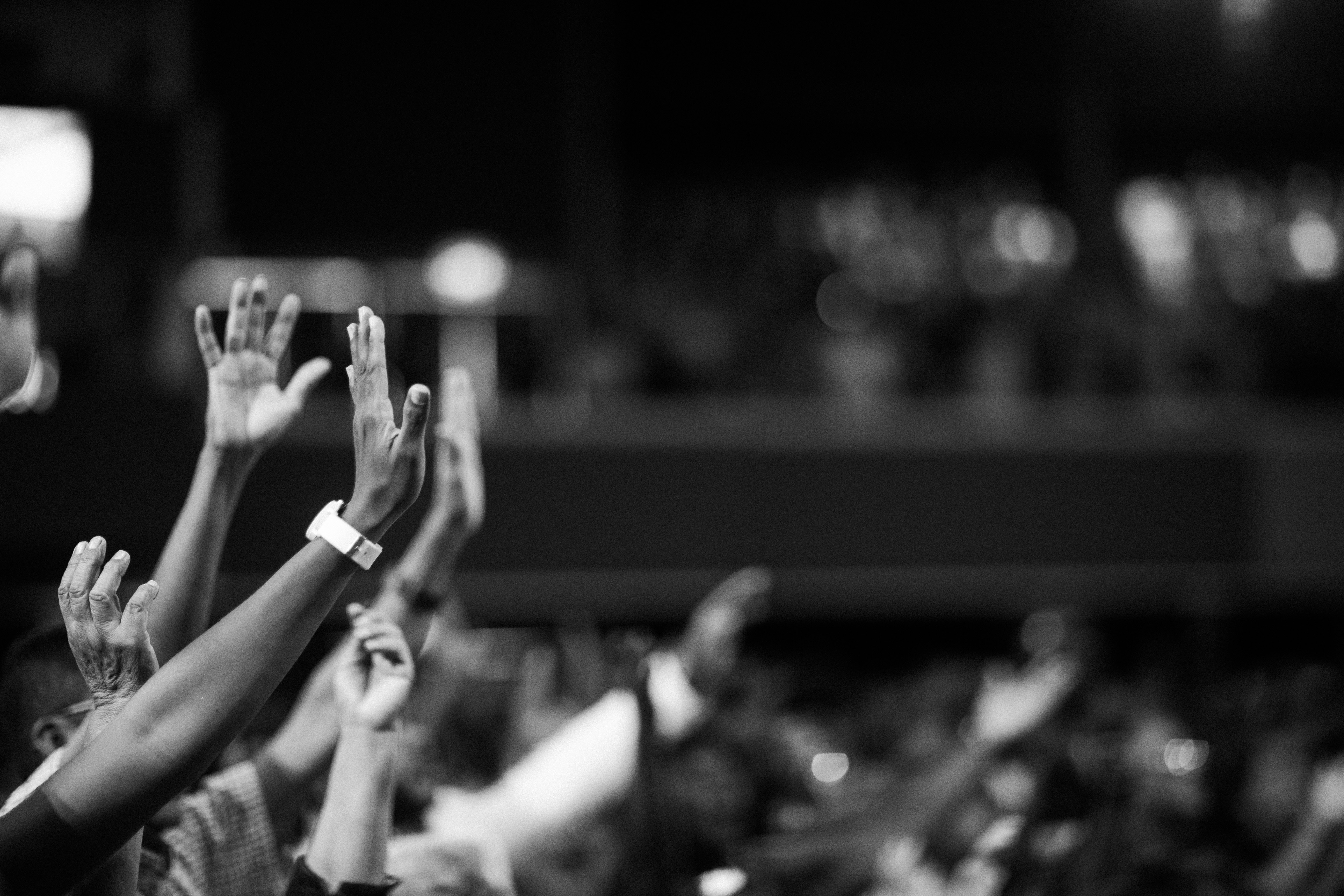 Grayscale Photography Of Hands Waving · Free Stock Photo