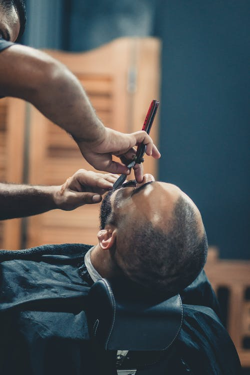 Person Shaving Beard