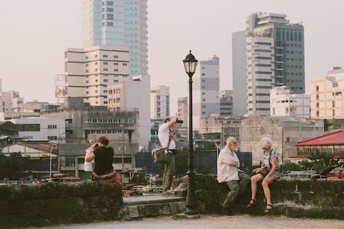 People Sitting on Railing